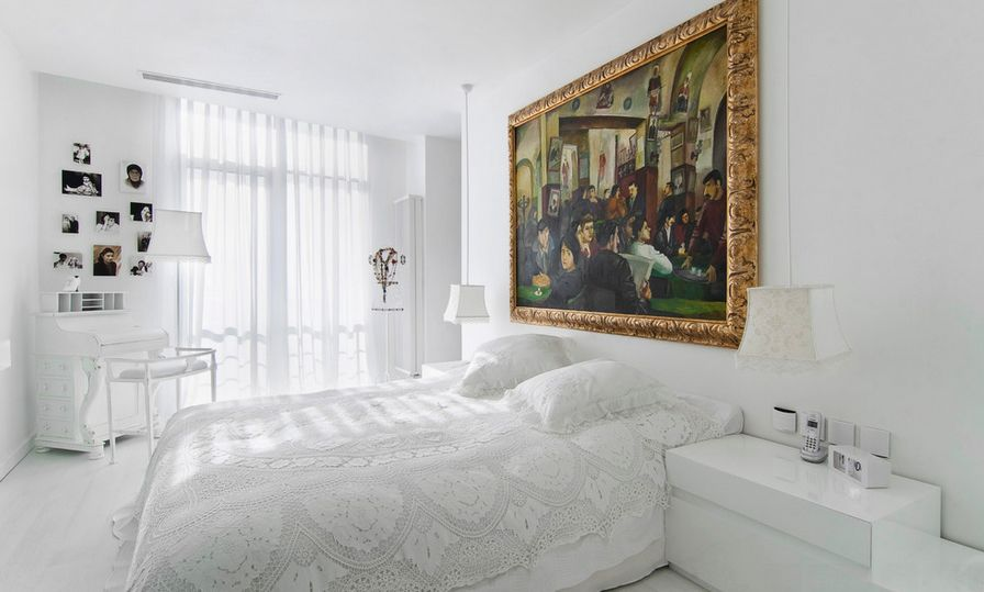 bedroom with a painting over the bed
