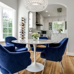 Tulip Table And Chairs Bamboo Couch The Bloom That Doesn T Fade Saarinen S Comfortable Blue Armchairs For