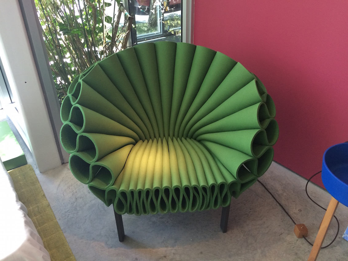 the revolving chair miami beige wingback poltrona frau group showroom is an interior design delight