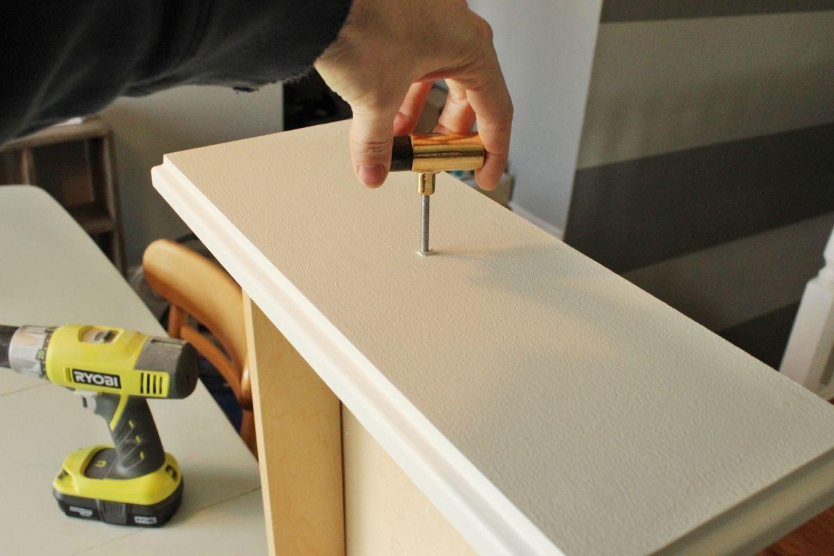 DIY Upgrade Bathroom Vanity- attach new hardware