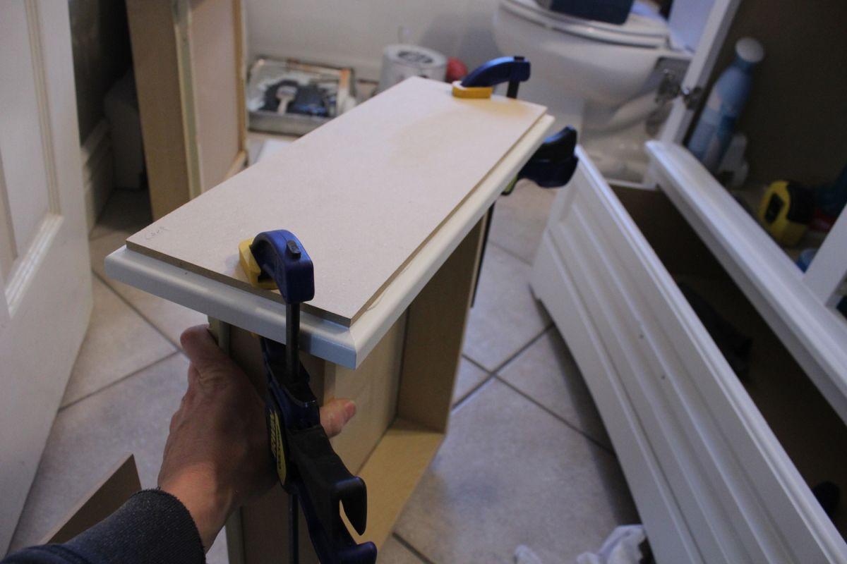 DIY Upgrade Bathroom Vanity-clamp mdf board