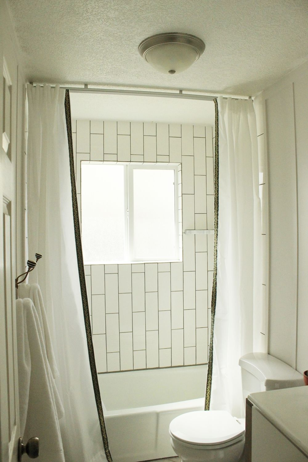 install a ceiling mounted shower curtain