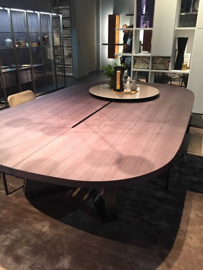 Large oval dining table with a thiny space on center