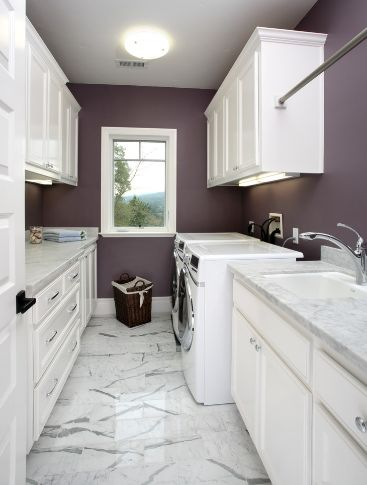 Laundry room with marble floor and contrast walls