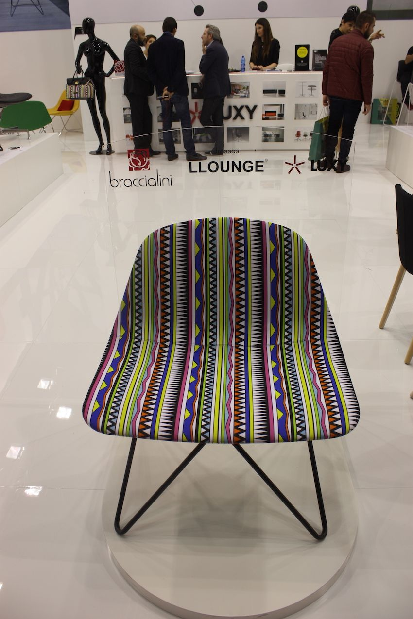 The L Lounge by Luxy would be great as a family dining chair, This one is upholstered in a bright and cheery fabric and the pin legs make it especially light and modern.