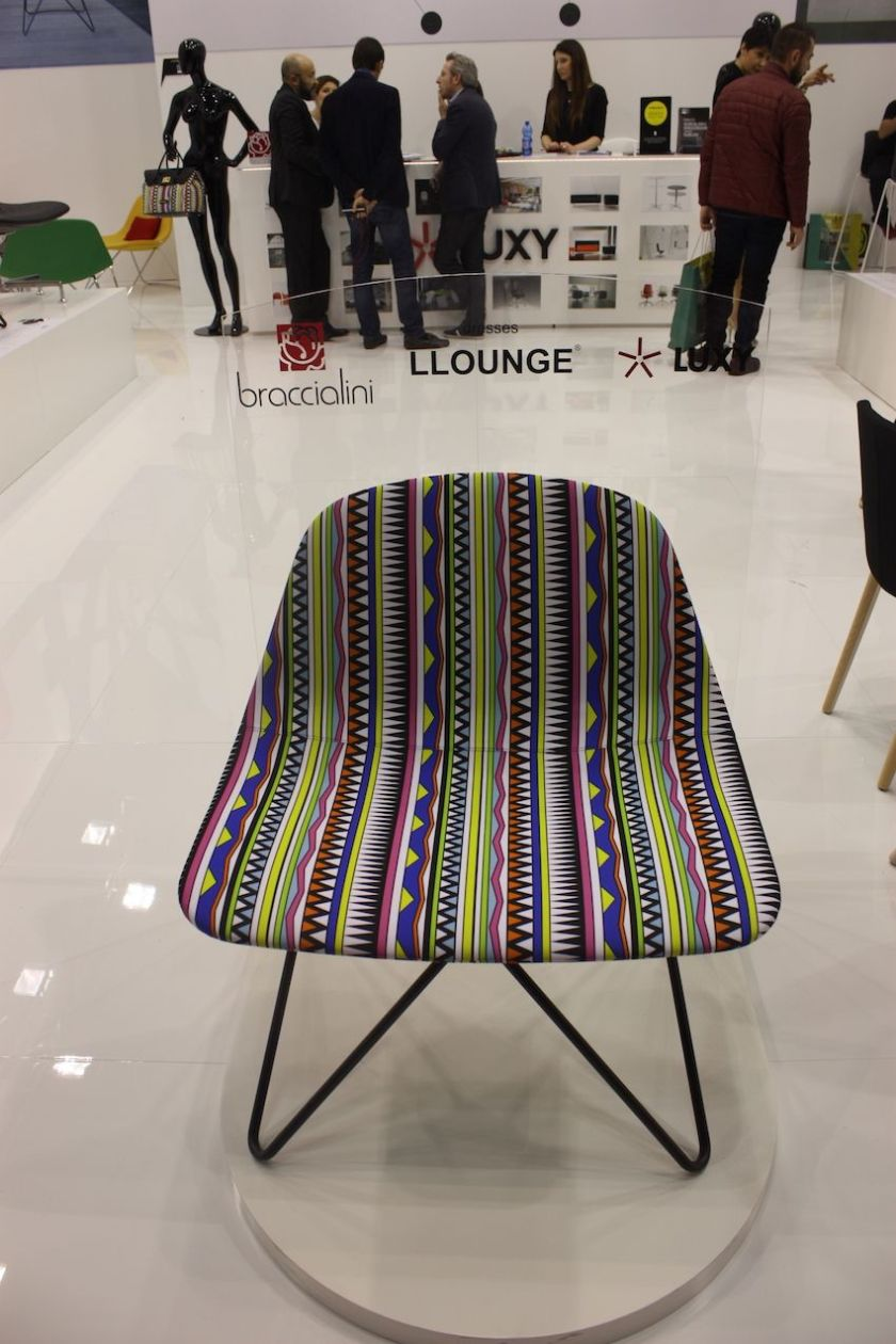 The L Lounge by Luxywould be great as a family dining chair, This one is upholstered in a bright and cheery fabric and the pin legs make it especially light and modern.