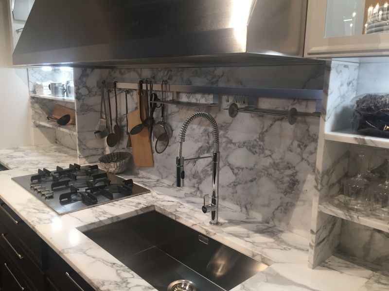 Marble backsplash for kitchen with stainless steel hanging pots