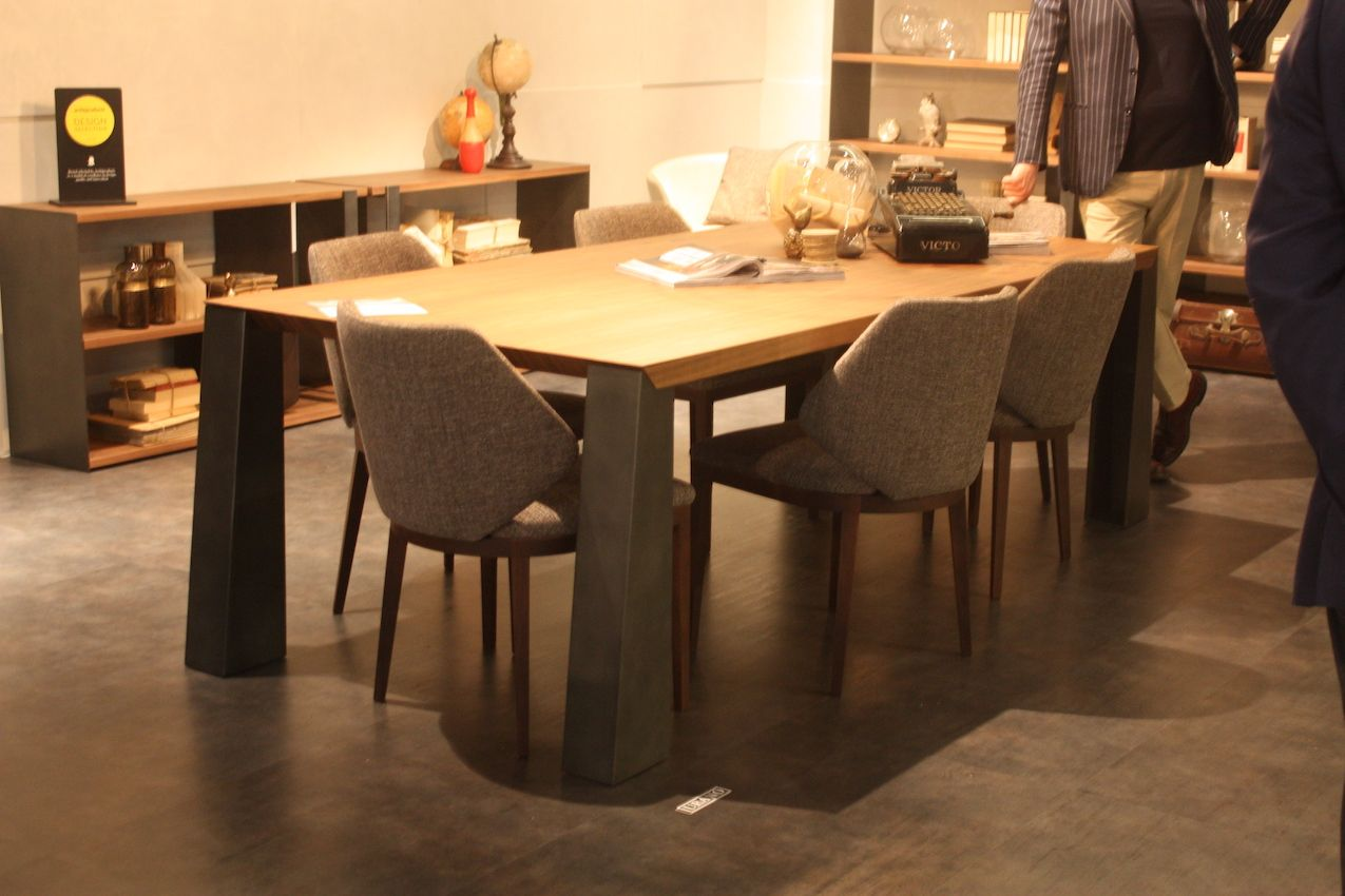 This dining set from MaxDivani includes stylish wood and tweed dining chairs that are versatile enough for a dining room or a family kitchen setting.