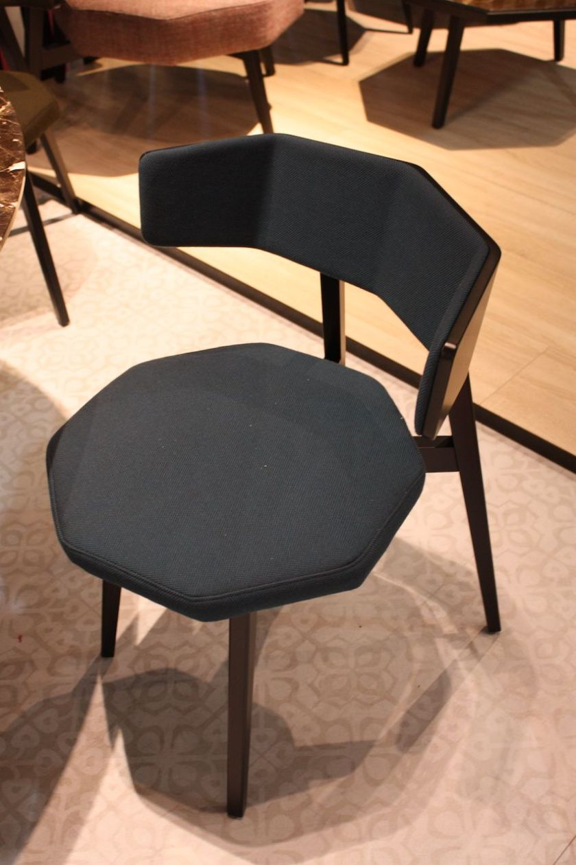 The octagonal shaped seat of this modern dining chair from Potocco is unusual, as is the showed back that follows half of the octagon. Upholstery on both the seat and back increase the comfort of the design.