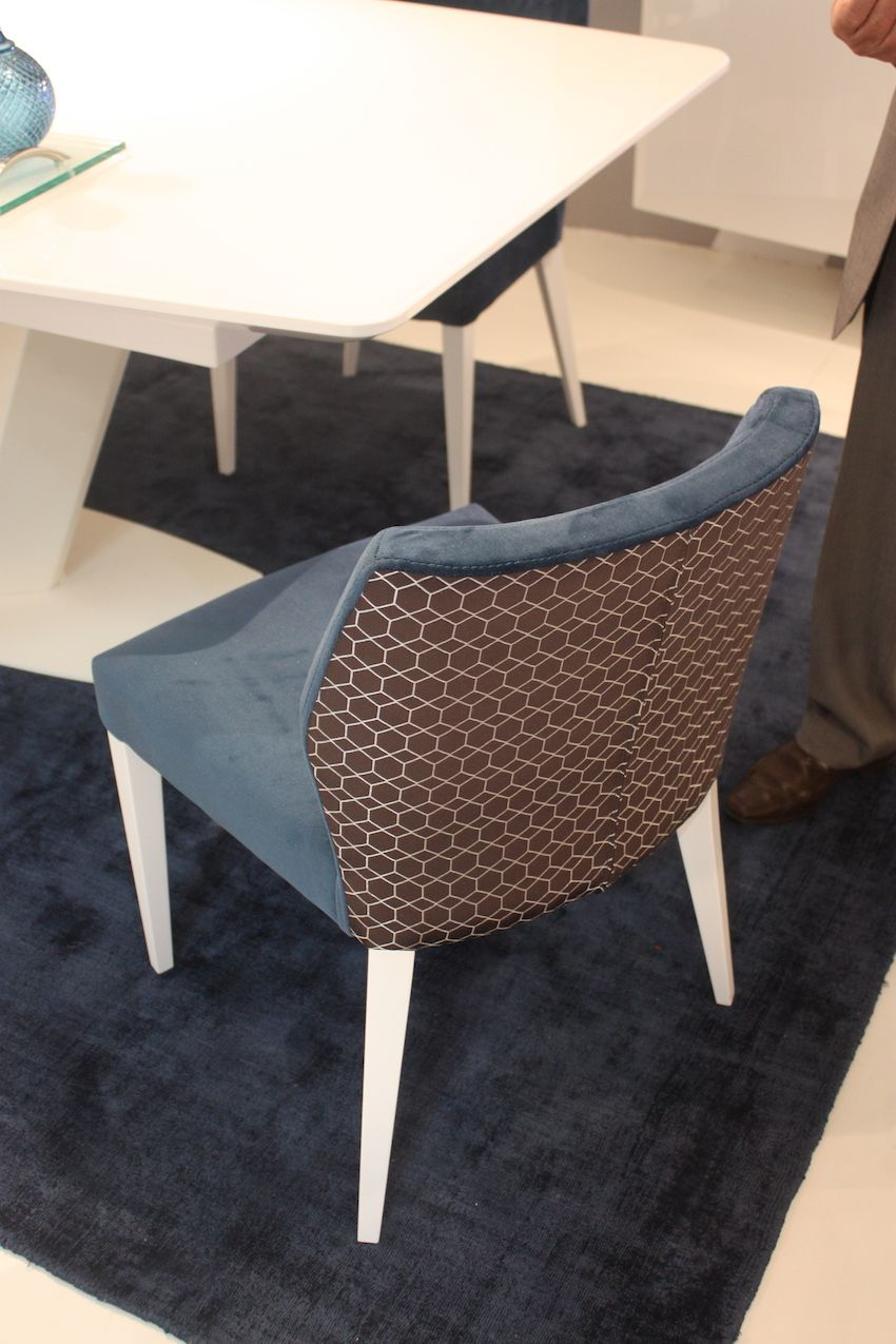 styles of living room chairs how can i decorate my on a budget new dining offer style and comfort another chair from mobilario is upholstered in two different fabrics the front
