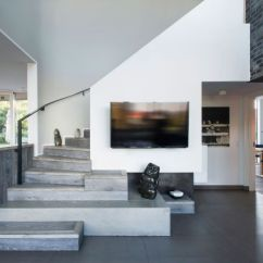 Tv Wall Unit Design For Living Room Victorian Decor Danish Villa Has Two Floors That Mirror Each Other