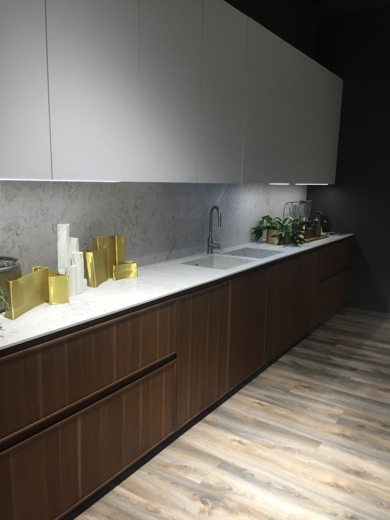 Wood cupboads and white barble backsplash