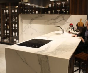 Wood kitchen cupboard and marble backsplash