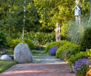 Big rocks and statues create a cool garden