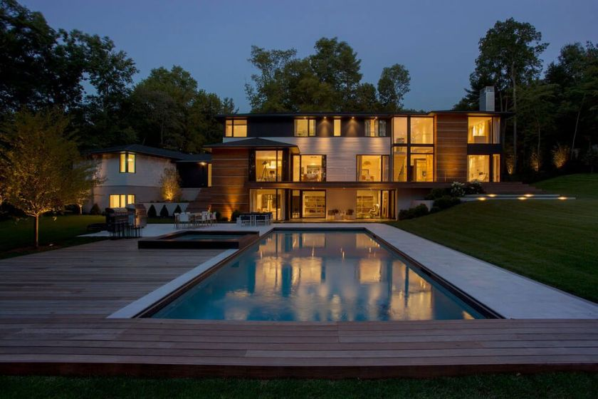Ledgewood Residence with a pool blended in a beautiful deck