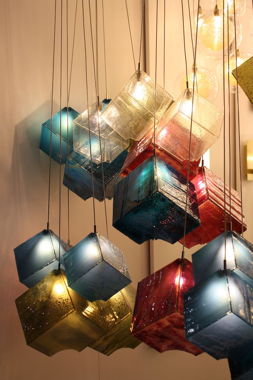 Out favorite is the Noga, which consists of clusters of glass cubes that have jagged edge corners. The combination of colors and slightly rough cubes makes for a fantastical light fixture.