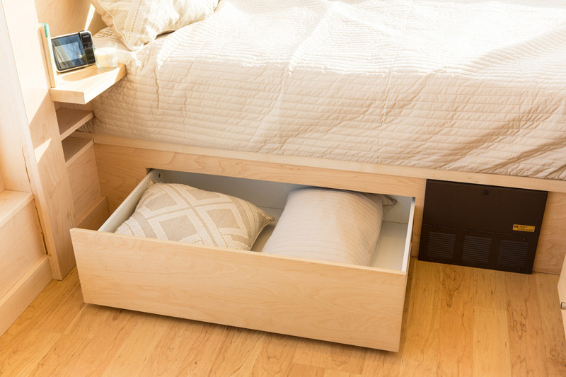 Small tiny home on wheels drawer bed storage