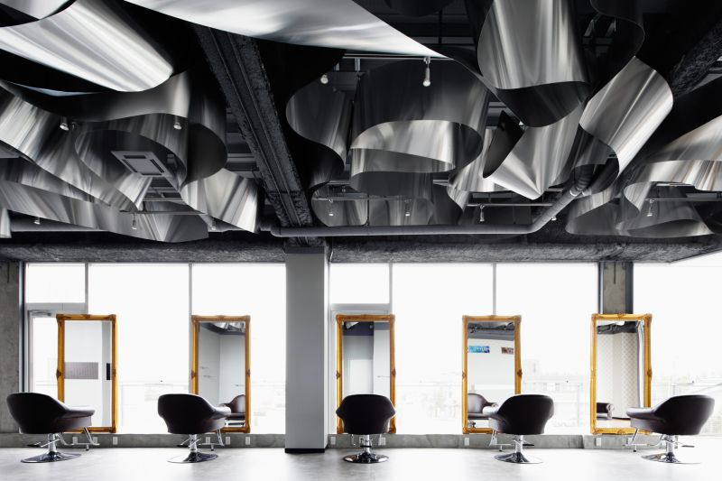 ARKHE Beauty Salon with an impressive ceiling and gold mirrors