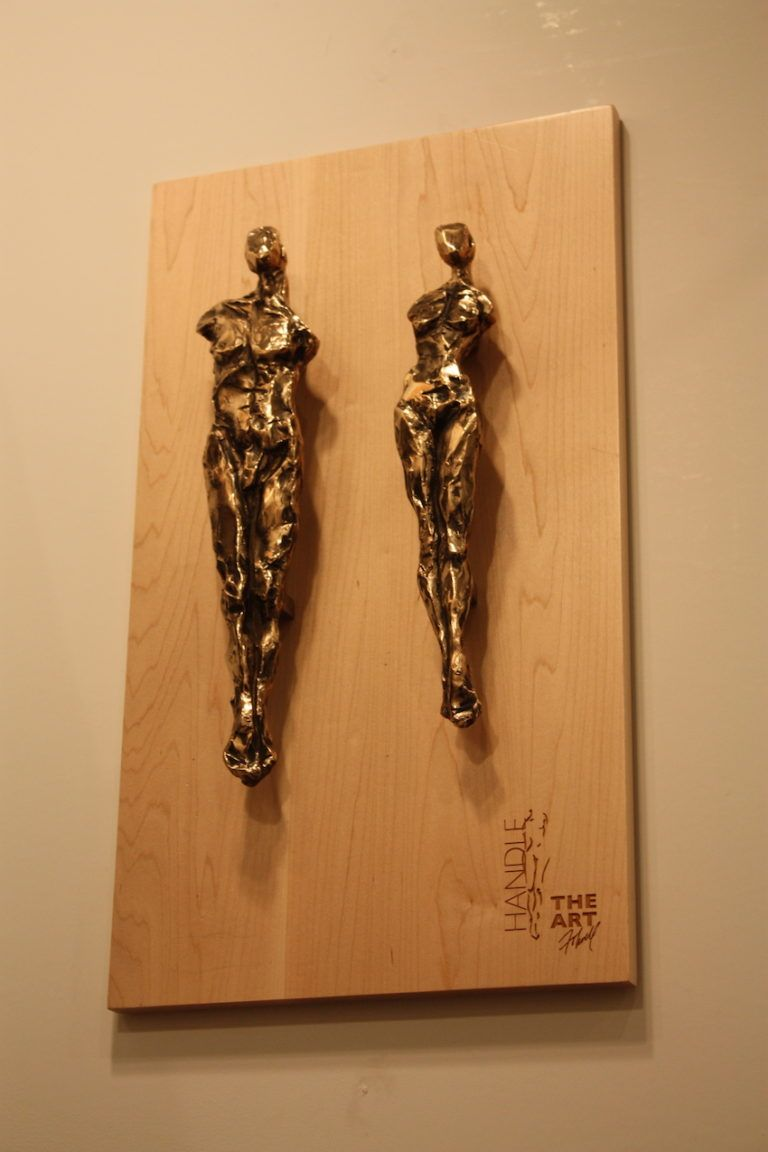 """These are """"Adam"""" and """"Eve"""" door pulls. Folwell has created pieces that are in private collections nationwide, including the Denver Art Museum, Pro Football Hall of Fame, Vail Resorts and Silver Oak Cellars."""