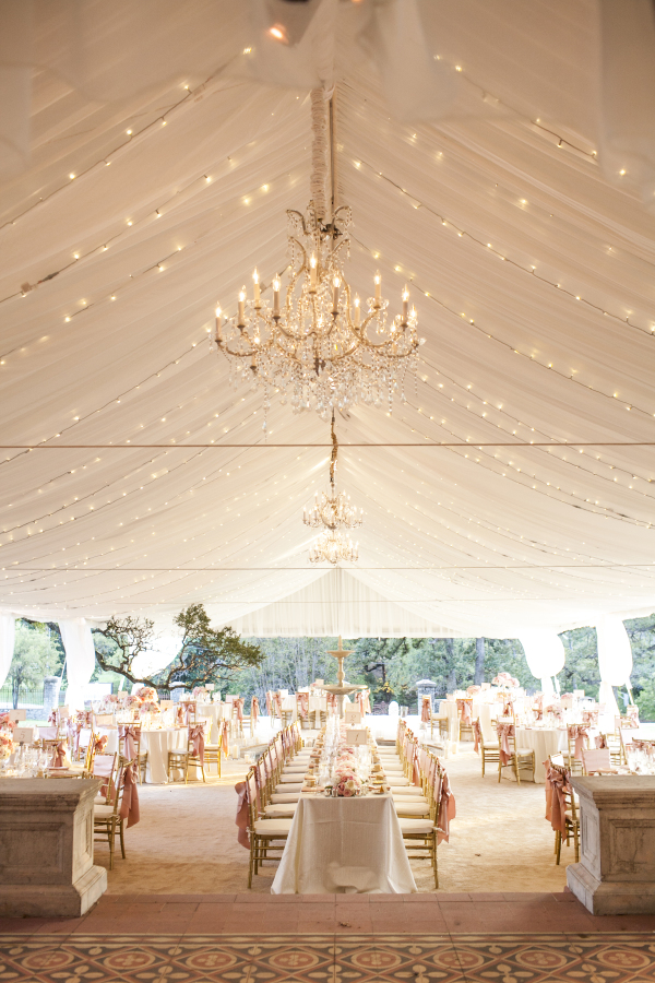 Bohemiand and romantic wedding tent design with a big chandeliers