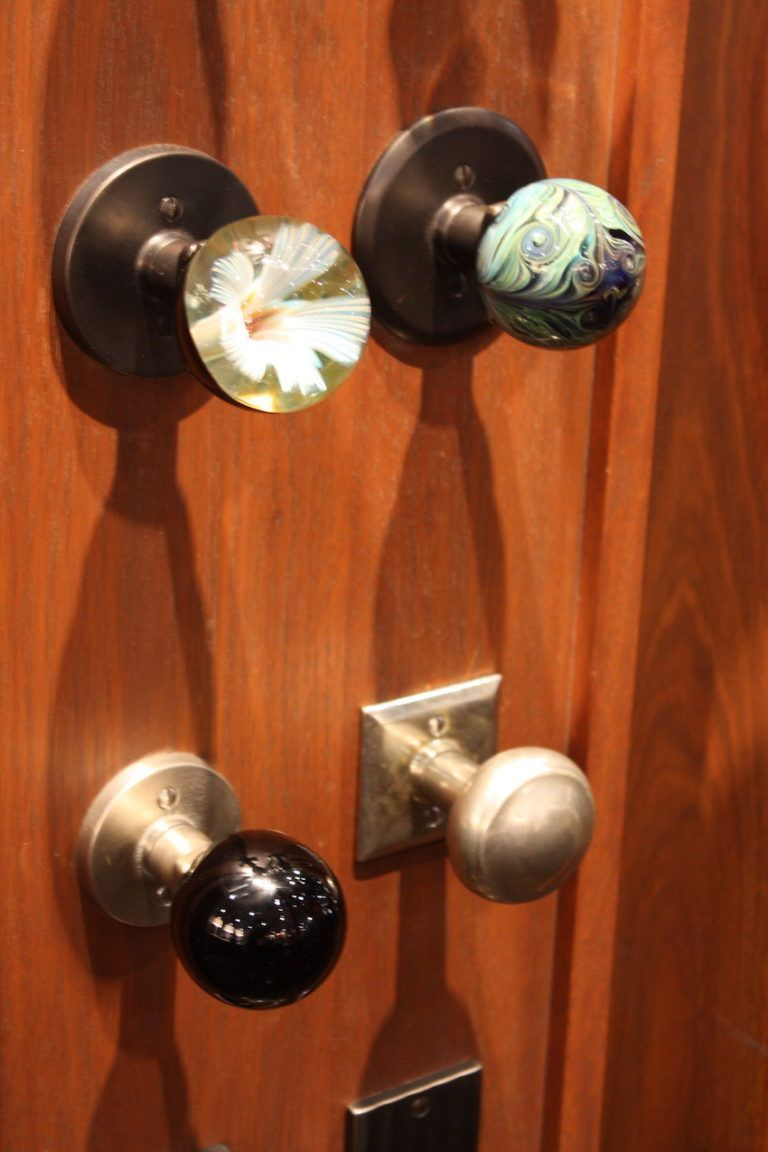 When it comes to smaller, elegant knobs, the Sun Valley Bronze selection includes wood inlay knows as well as orange of gorgeous art glass knobs. These two -- one marbles, one with a floral design -- are our favorites.