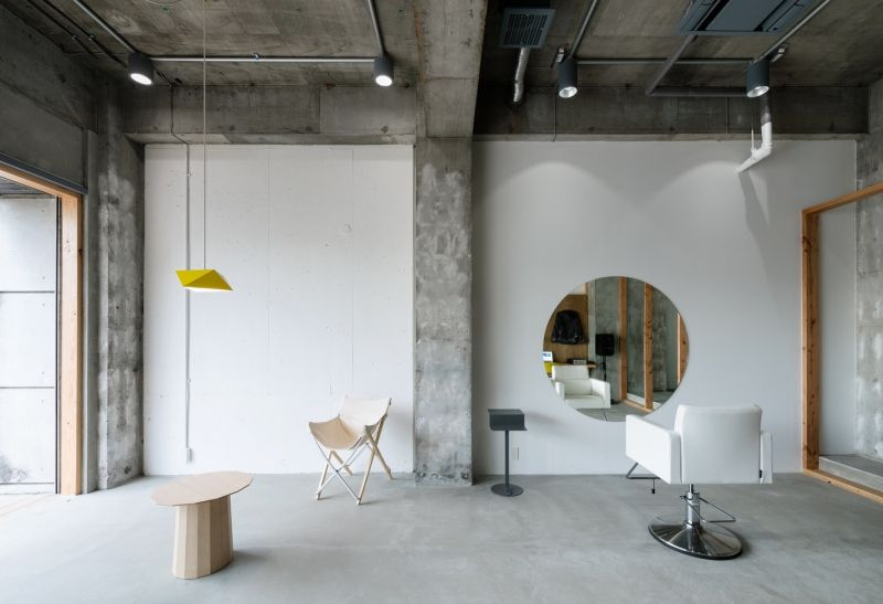 Equip Hair Salon with exposed concrete