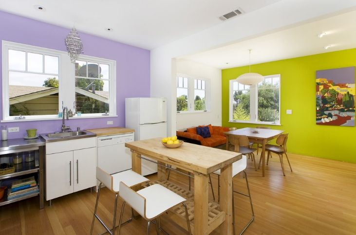 Green and levender walls for an open space kitchen