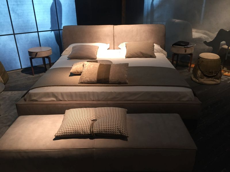 Leather bed design with cool nighstand like stools