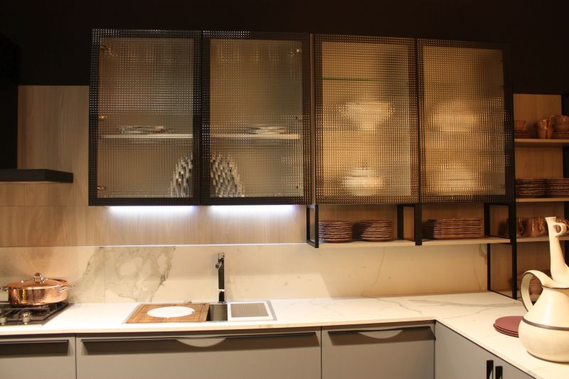 kitchen counter lighting undermount sinks lowes under cabinet led puts the spotlight on marble with frosted glass for doors and