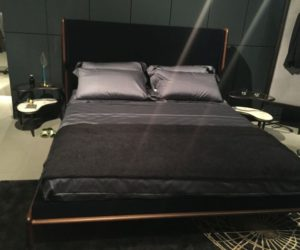 Mid century bed frame and dark bedding
