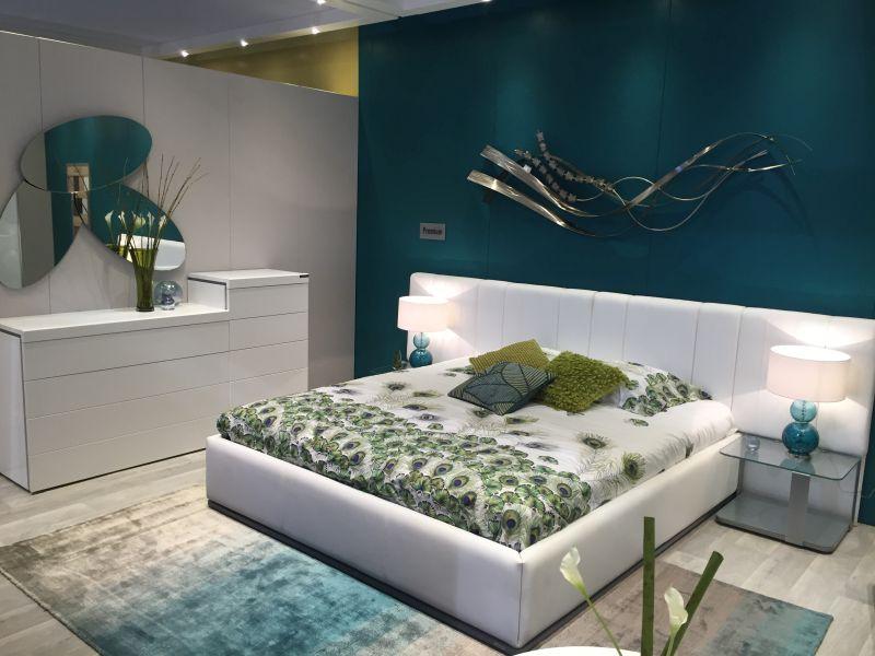 Modern metallic wall art sculputre above bed