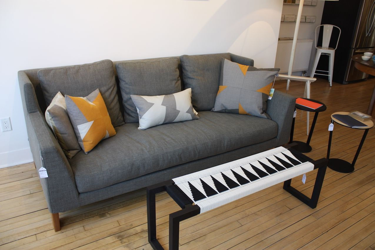 Here, the Morgan sofa by Bensen is paired with the Fireside Bench (which can also act as a coffee table) by Peg Woodworking. We're already fans of Peg, having seen designer Kate Casey most recently at Brooklyn Design. Her artful pieces combine materials, hand made joinery, Danish cord weaving, crochet, macrame and shaker techniques. On the right are two Around tables, also by Bensen.