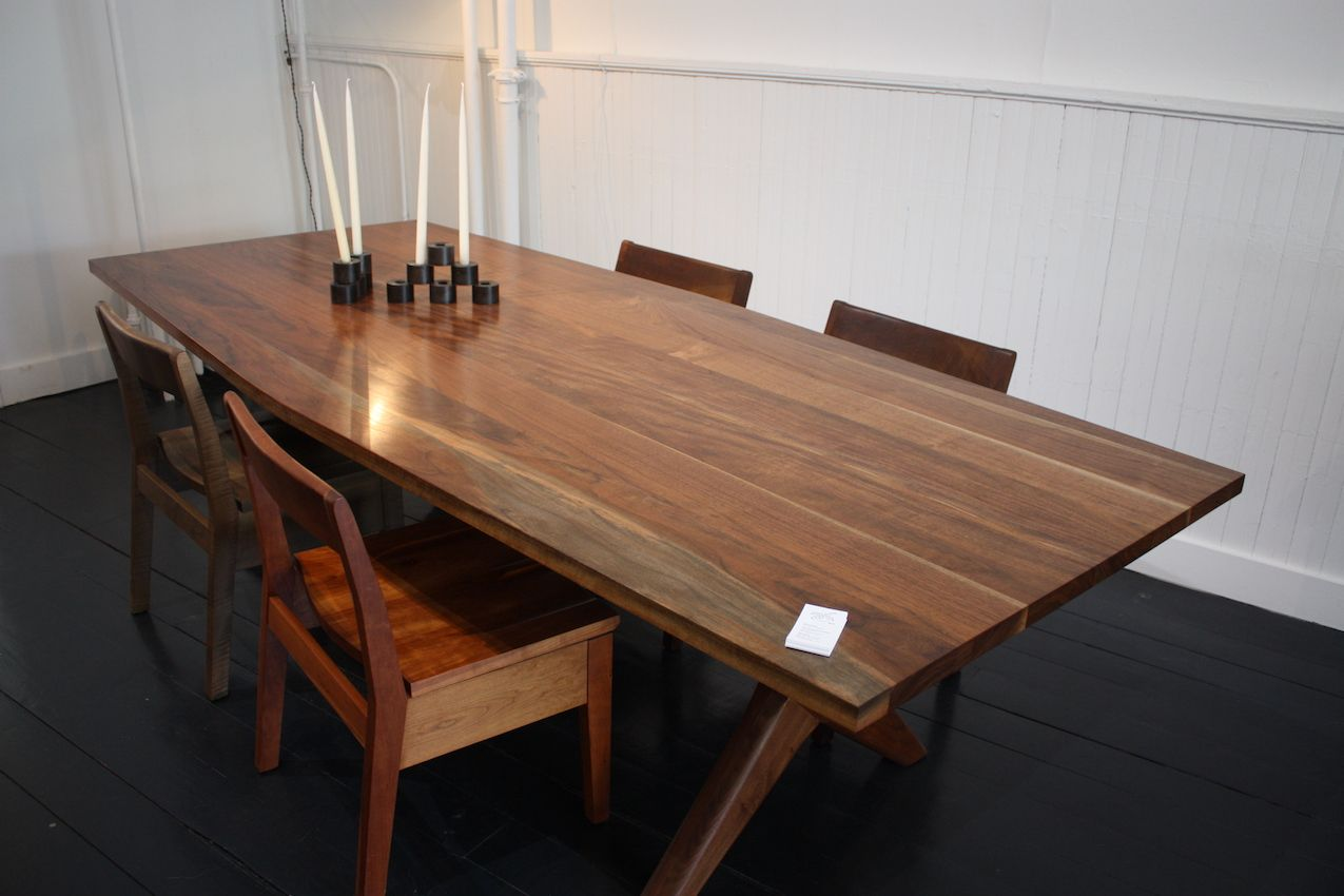 Fern's Founders Dining Table is a modern take on a Sawbuck table. It has mortise and tenon joinery and your choice of a hexagonal or rectangular top. You can even order one in a 12-foot length! Certainly big enough for your next holiday dinner, no? This beautiful table is paired with the Sawyer Dining Chair, which has a hand-carved seat and oversized stretchers.
