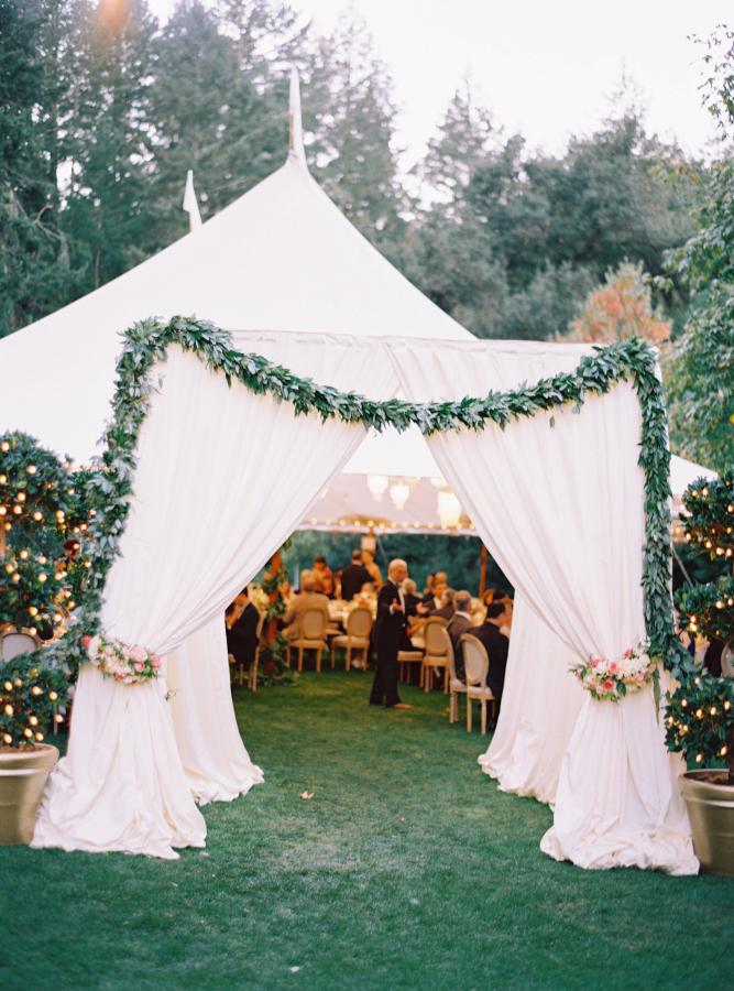 Tent wedding arch