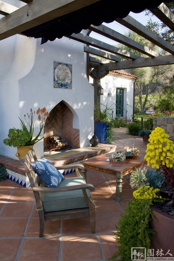 White spanish backyard fireplace