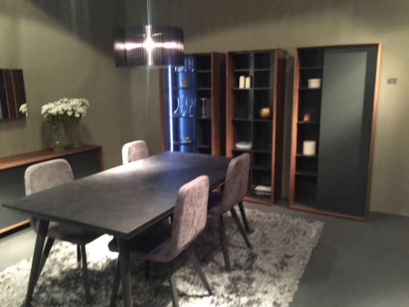 Black rectangular dining table with velvet chairs