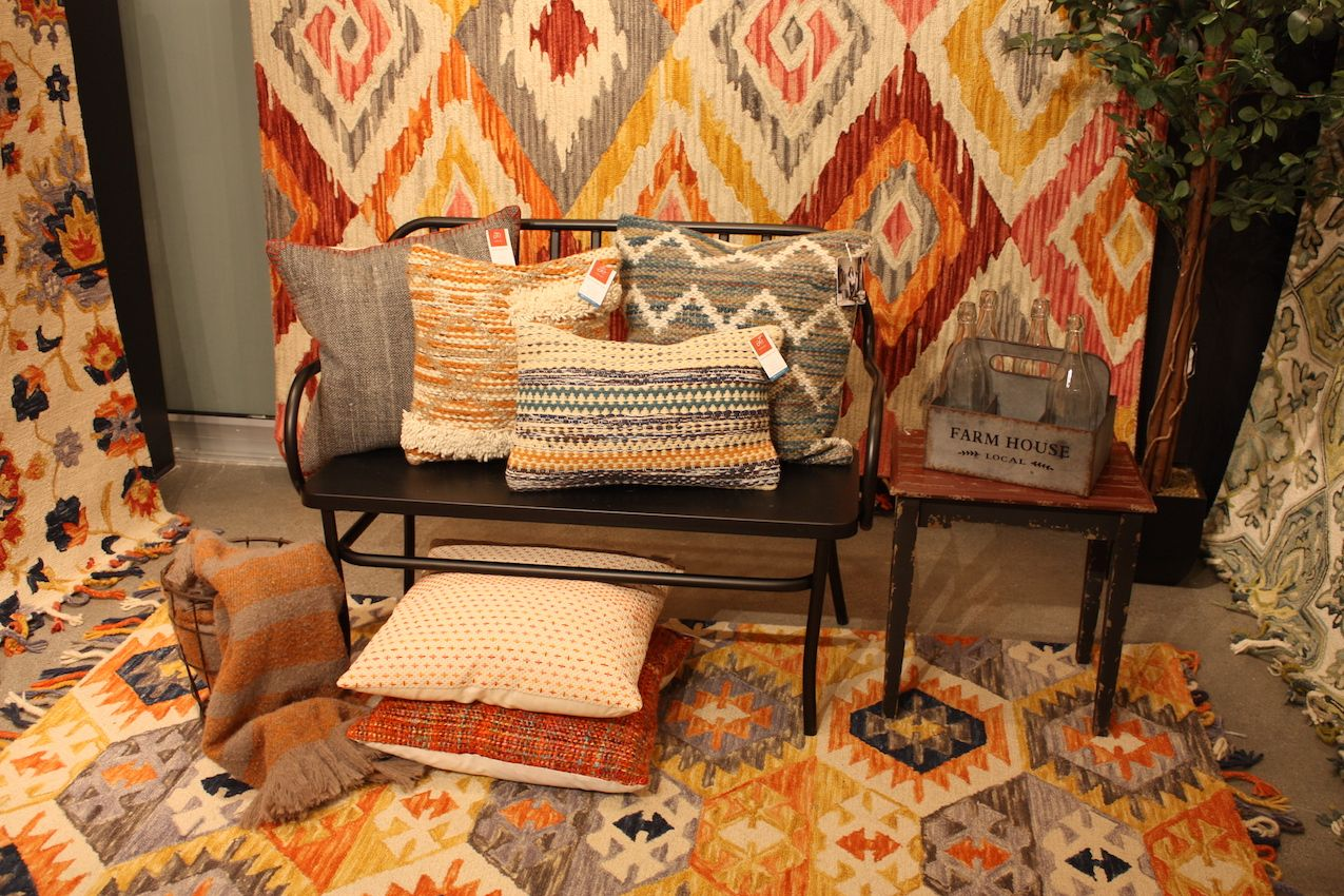 The rugs, presented by Loloi, have a slight Southwestern feel.