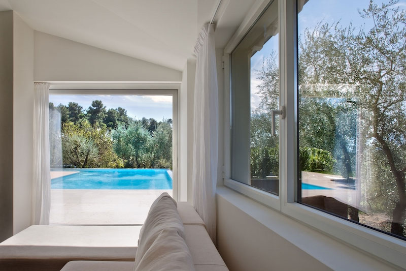 Renovated country house in Lucca view of the pool from inside