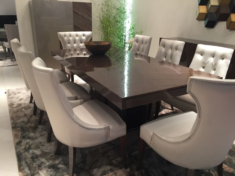 Traditional dining table with leather tufted chairs