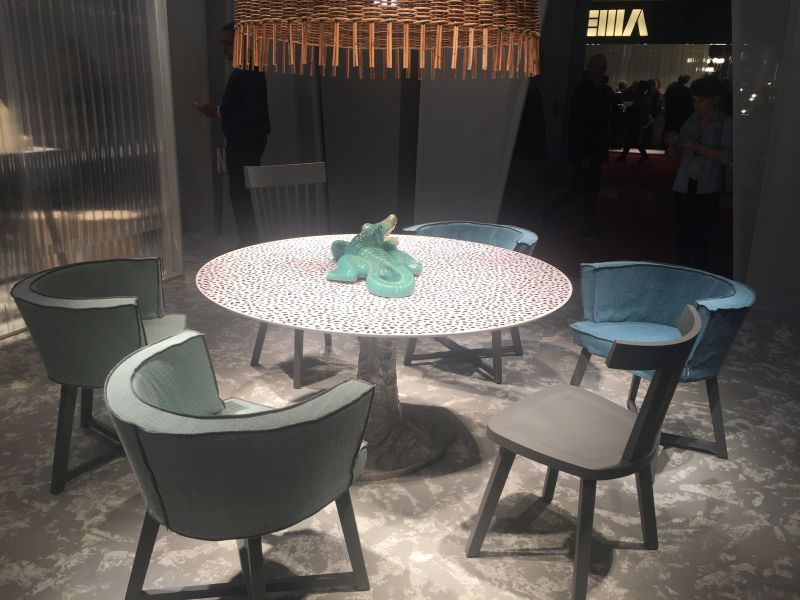 Unique dining table with a round design and diff chairs