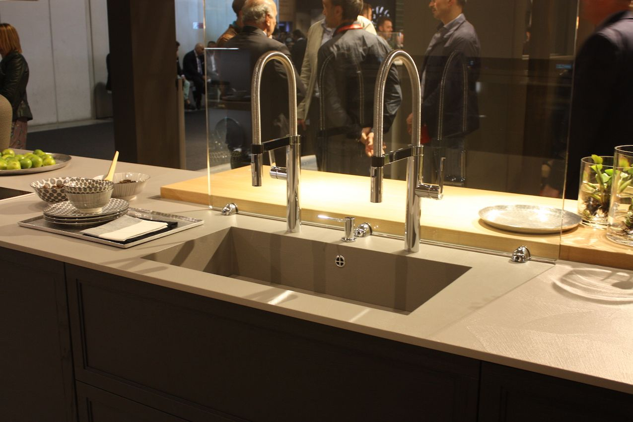 Arrex shows a large single sink with two high neck faucets.