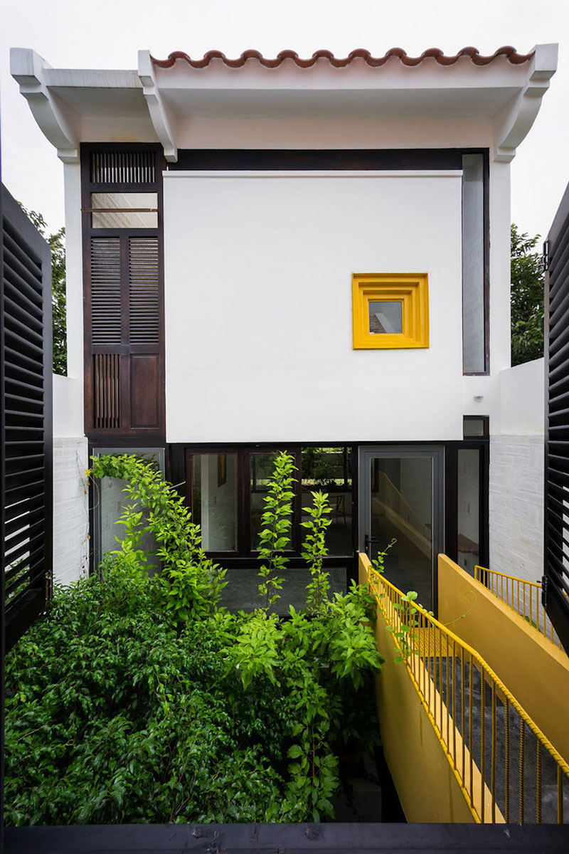 Can Tho House yellow window frame