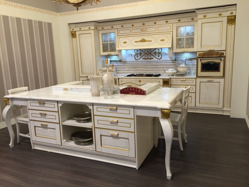 Traditional looks like this French provincial style can still incorporate the latest kitchen technologies and conveniences.
