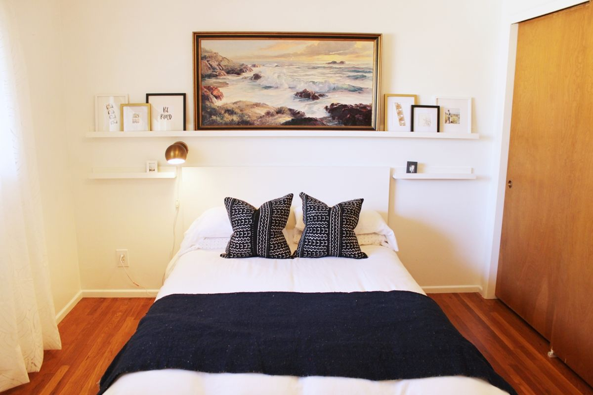 Bedroom with large oil painting