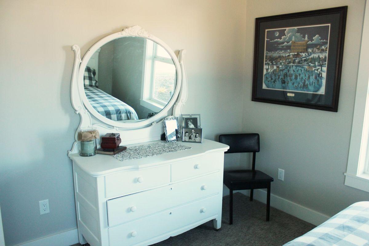 Guest Bedroom with scalloped-edge mirror vanity