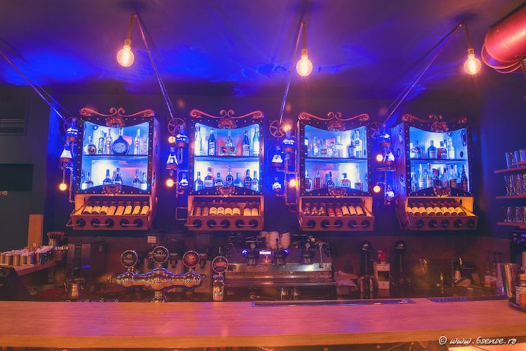 The bar front is decorated with cog wheels, chains and lights
