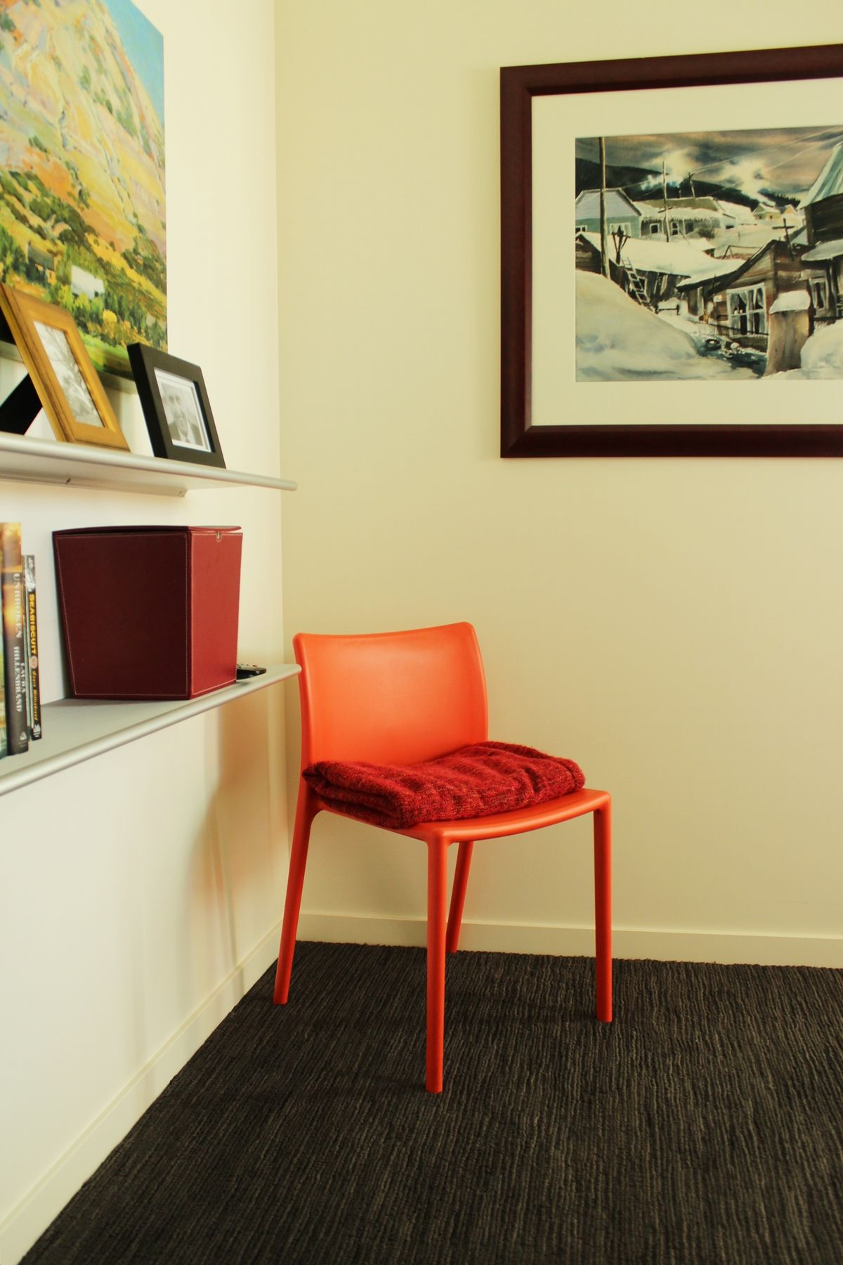 Master bedroom red chair