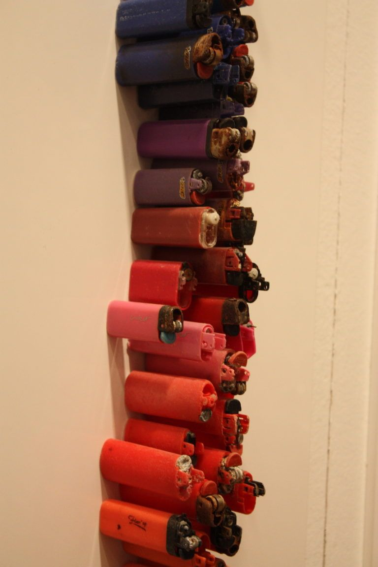 Lighters of many sizes were salvaged forthe piece.