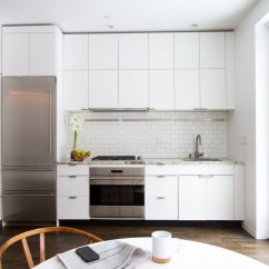 White Tile Backsplash Kitchen Moen Anabelle Faucet Cabinets The Perfect Backdrop For A Chic Decor