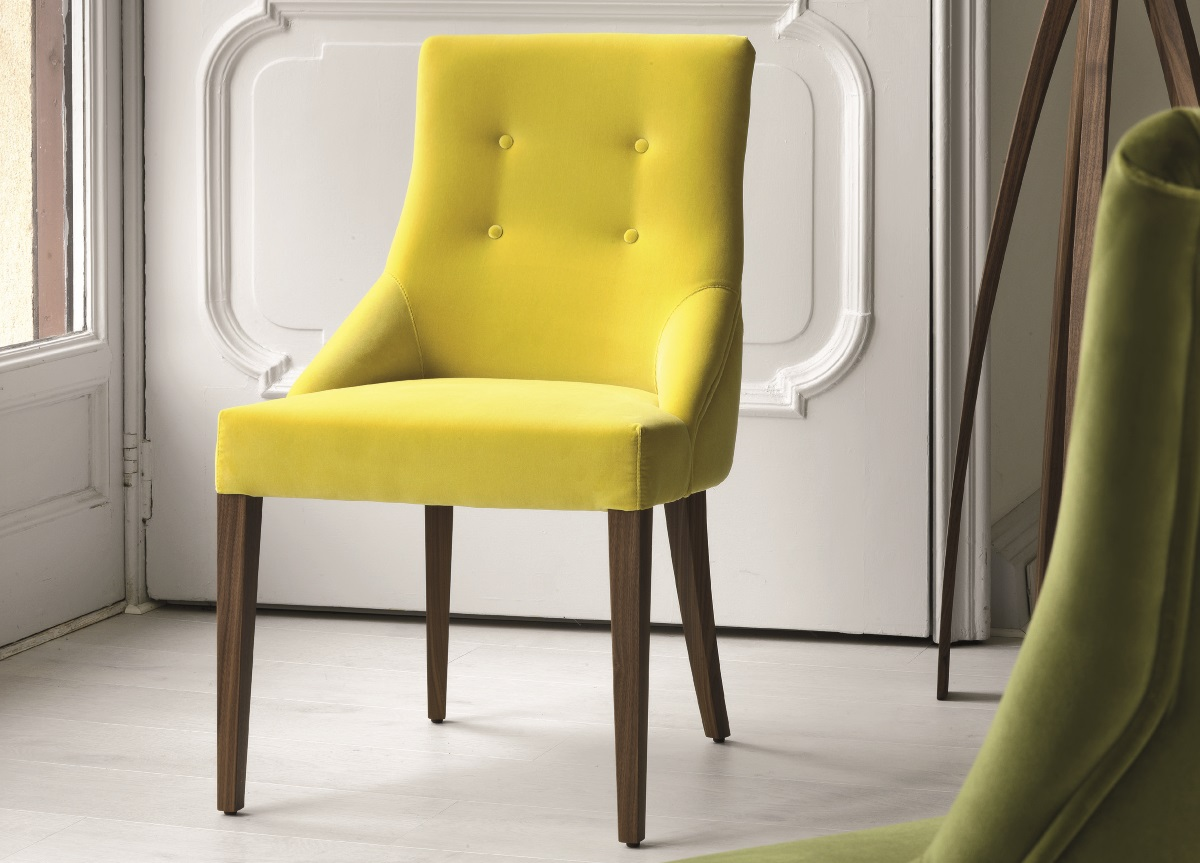 tufted yellow chair anti gravity with side table upholstered dining chairs when style meets ergonomics